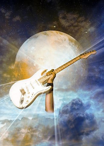 Stylised guitar in front of planet