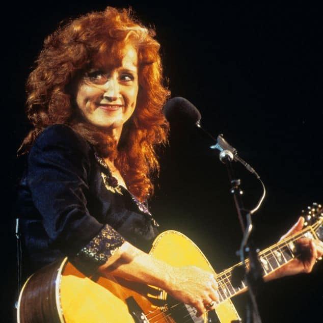 Bonnie Raitt with her guitar