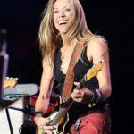 Rock woman playing guitar